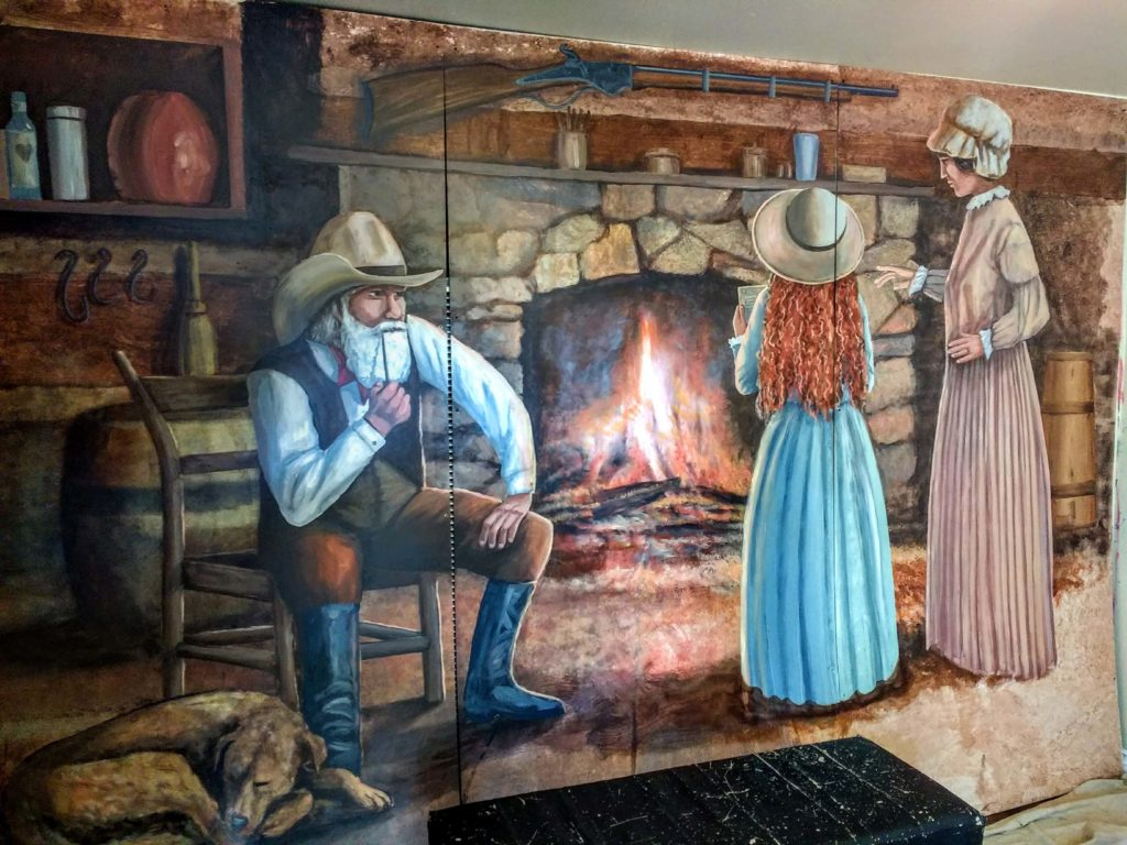 Mural dedication - The Pioneer Cabin - by artist Rik Erickson at the Pott Belly Shop